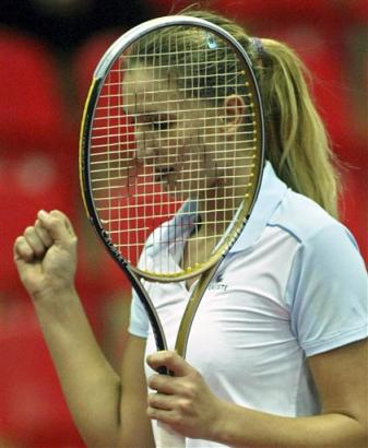 联合会杯网球赛(世界女子网球团体赛)半决赛24日在莫斯科开...