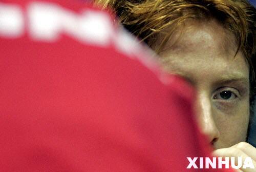 ...看其他选手比赛.当日,在2005年国际乒联职业巡回赛总决赛男