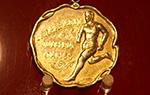 一篇报道 一段佳话——中国首枚国际体育赛事金牌入藏记